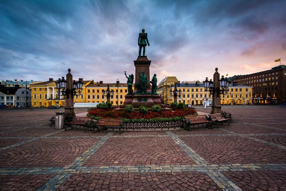 Garden and statue of Alexander II at sunset, at Senaatintori, Senate Square in Helsinki, Finland..jpeg