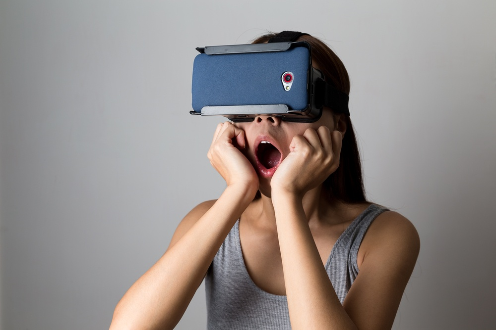 Young Woman feeling shocking for using the virtual reality device.jpeg